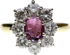 Large Ruby and Diamond Oval Cluster