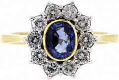 Rim Set Oval Sapphire with Claw Set Diamonds Cluster Ring