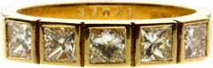 Graduated Princess Cut Rim Set in Raised Boxes in 18ct Yellow Gold
