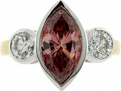 Large Marquise Shaped Enhanced Pink Diamond Three Stone Ring